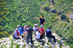 Tourists and guide on cliff edge, Israel Stock Photos