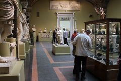 Tourists in the hall of Roman art. Royalty Free Stock Photo