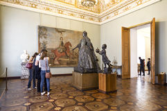Tourists in the hall with a statue of the  Russian Empress Anna Ivanovna of the famous sculptor Rastrelli  in Russian Museum Royalty Free Stock Photos