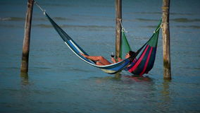 Tourists in Hammocks stock video
