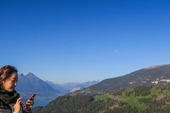 Tourists at Harder Kulm taking pictures of the stunning view royalty free stock photo