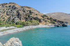 Tourists have a rest on the Preveli Beach Stock Photo