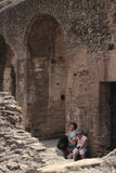 Tourists having a break at Colosseum Royalty Free Stock Photography
