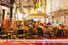 Tourists are having dinner in the restaurant at night, Trogir, C Royalty Free Stock Photography