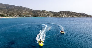 Tourists having fun on inflatable watercraft boat at the beautif Stock Photos