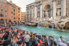 Tourists having fun by Trevi Fountain in Rome
