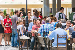 Tourists Having Lunch At Outdoor Restaurant Royalty Free Stock Photo