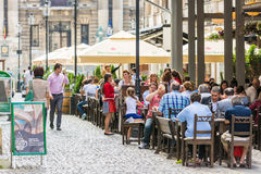 Tourists Having Lunch At Outdoor Restaurant Stock Photo