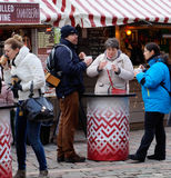 Tourists having meal on Christmas market stock photos