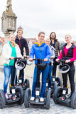 Tourists having Segway sightseeing Stock Images