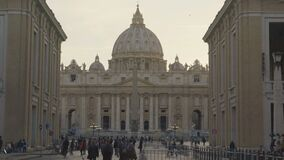 Tourists heading for St Peter's Square in Vatican City, travel to see landmarks. Stock footage stock footage