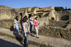 Tourists in Herculaneum in Italy Stock Photography