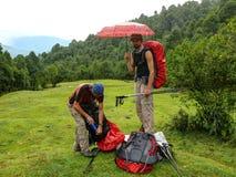 Tourists hiding from the rain, Nepal Stock Photo