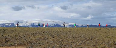 Tourists hike in Iceland. Near the Arch Dyrholaey stock images