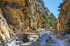 Tourists hike in Samaria Gorge in central Crete, Greece Royalty Free Stock Images