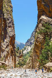 Tourists hike in Samaria Gorge in central Crete Royalty Free Stock Image
