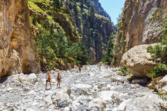 Tourists hike in Samaria Gorge in central Crete, Greece Stock Photo