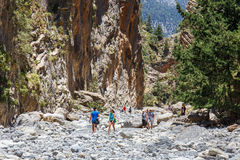 Tourists hike in Samaria Gorge in central Crete, Greece. The national park is a UNESCO Biosph Stock Photo