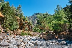 Tourists hike in Samaria Gorge in central Crete, Greece. The national park is a UNESCO Biosphere Rese. Crete, Greece, May 26, 2016: Tourists hike in Samaria stock images