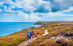 Tourists hiking at coasts of Bretagne, France Royalty Free Stock Photo