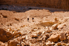 Tourists hiking in dead sea mountains Royalty Free Stock Image