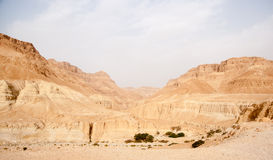 Tourists Hiking In Dead Sea Mountains Royalty Free Stock Images