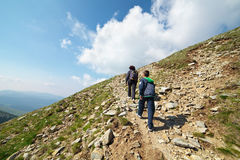 Tourists hiking on Iezer peak in Parang Royalty Free Stock Photos