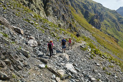 Tourists hiking on mountain trail Royalty Free Stock Images