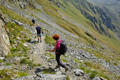 Tourists hiking on mountain trail Royalty Free Stock Photography