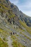 Tourists hiking on mountain trail Royalty Free Stock Photos