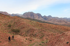 Tourists hiking the mountains in the Feynan natural Reserve in Jordan Stock Photos