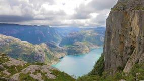 Tourists hiking at the Preikestolen cliff in lysefjorden Norway