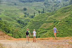 Tourists hiking in Sa Pa, Vietnam Stock Photo