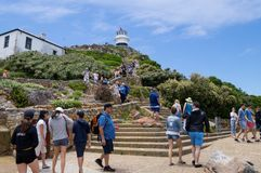 Tourists hiking to the lighthouse on top of Capepoint stock images