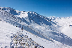 Tourists hiking in winter mountains in Kazakhstan. Royalty Free Stock Photo