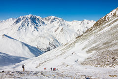 Tourists hiking in winter mountains in Kazakhstan. Royalty Free Stock Photos