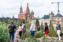 Tourists on hill in Zaryadye park and Kremlin Stock Photos