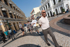 Tourists on the historic Senado Square in Macau Royalty Free Stock Images