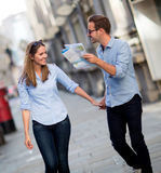 Tourists holding a map Stock Photography