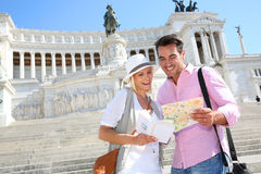Tourists holding a map in front of Victor Emmanuel II monument Stock Photos