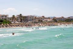 Tourists on holidays at Playa de Muro beach in Alcudia bay, Majorca. Tourists on holidays at Playa de Muro beach in Alcudia bay, Mallorca, Balearic islands Stock Photo
