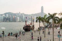 Tourists in Hong Kong waterfront promenade Royalty Free Stock Image