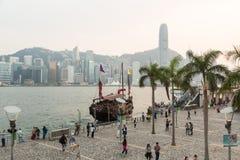Tourists in Hong Kong waterfront promenade Royalty Free Stock Image