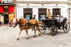 Tourists in a horse carriage in Bratislava, Slovakia Stock Photo