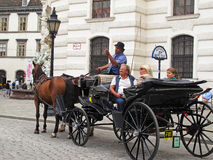 Tourists on a horse carriage Stock Photo