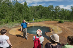 Tourists at hot spring Griffin by Ivanov. Kamchatka, Nalychevo Royalty Free Stock Photos