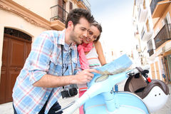 Tourists in ibiza checking the map Stock Photos