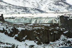 Tourists at the Icelandic waterfall Godafoss in wintertime Stock Photography