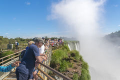 Tourists at Iguazu Falls Devil Throat Argentinian Border Stock Image