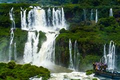 Tourists at Iguazu Falls royalty free stock photo